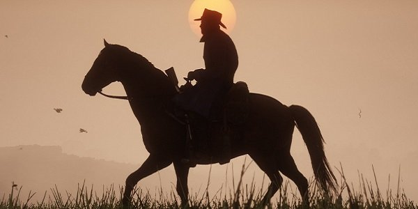 Arthur rides his horse against the setting sun.