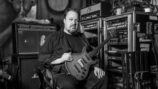 Marillion's Steve Rothery sitting with his guitar and amp at the Racket Club