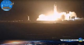 SpaceX's SN8 Starship prototype undergoes its third static fire test in Texas on Nov. 12, 2020.