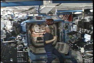 NASA Astronaut Tests Microsatellite Aboard Space Station