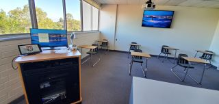 Diversified created hybrid classroom solutions at Harvard-Westlake School using solutions from Crestron, Shure, and more.