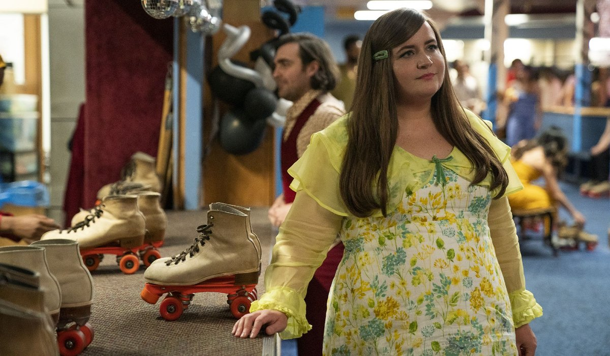 Aidy Bryant looks wistfully into the air at the roller rink in Shrill.