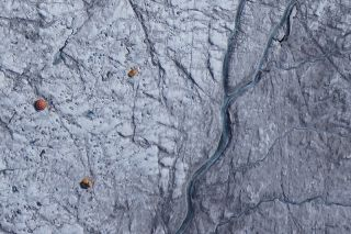 """""""Dark ice"""" on the right side of the photo is rich with impurities like soot and dust."""