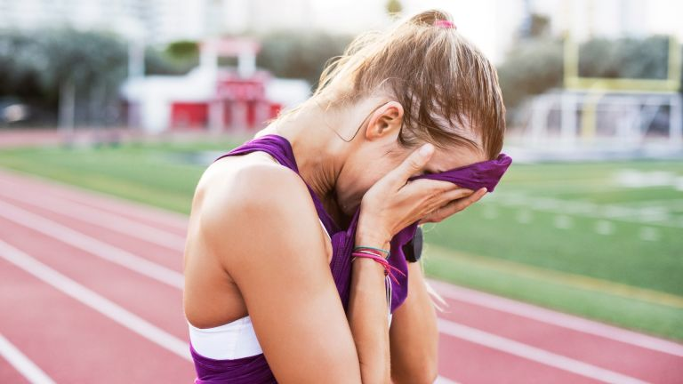 Woman suffering from anxiety whilst running