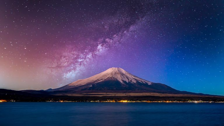 a mountain with a starry sky behind it