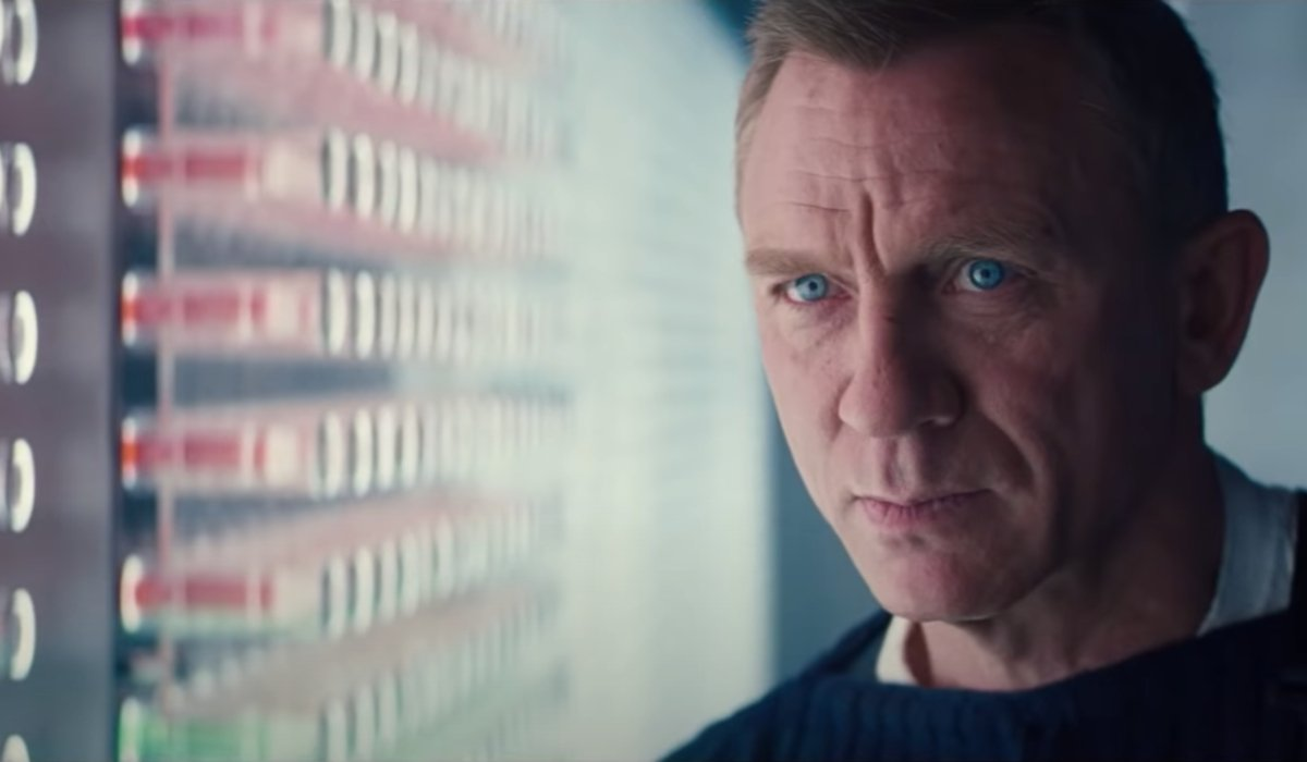 No Time To Die Daniel Craig glaring at a wall of vials