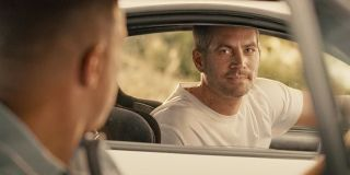 Paul Walker and Vin Diesel say goodbye in their cars in Furious 7.