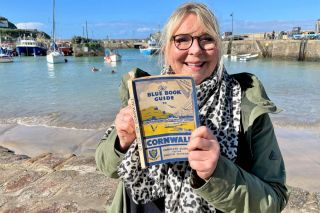 Fern Britton poses with a guide to Cornwall