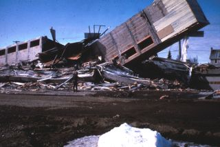 Alaska Earthquake March 27, 1964. The Four Seasons Apartments in Anchorage was a six-story lift-slab reinforced concrete building which cracked to the ground during the quake. Credit: USGS