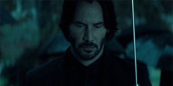 Keanu reeves is back as indie john wick over performs at for John wicks back tattoo