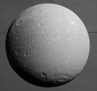 Dione with Saturn and its rings