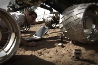 Curiosity Rover on sharp Mars rocks