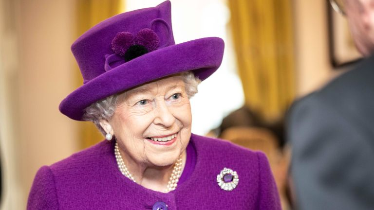 Queen Elizabeth II talks with residents in the new Appleton Lodge care facility run by the RBLI during a visit to the Royal British Legion Industries village to celebrate the charity's centenary year on November 6, 2019
