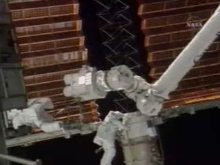 Astronauts Partially Furl ISS Solar Array in Spacewalk