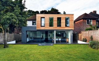 Alex and Sophie Nicholls have enlarged their traditional 1950s house with two contemporary box-shaped extensions designed to bring in the light