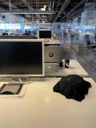 Unrelease Vive VR headset under a black sheet in an office