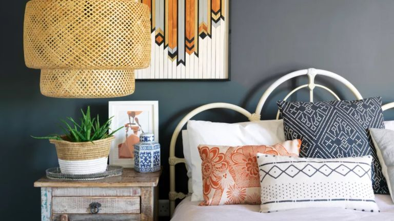 Blue boho bedroom with rattan light