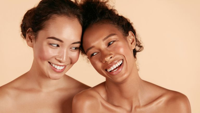 two smiling women with glowing skin and natural makeup