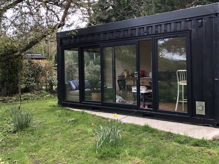 contemporary garden room: converted shipping container garden room