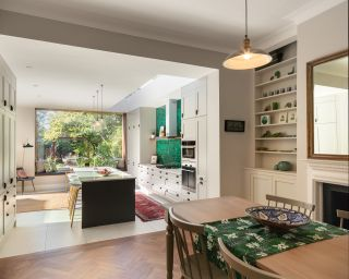 extension cost calculator - modern kitchen extension with green tiles