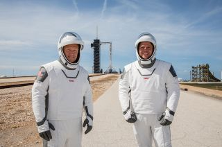 NASA astronauts Doug Hurley (at left) and Bob Behnken (right) participate in a dress rehearsal for their launch at the agency's Kennedy Space Center in Florida on May 23, 2020, ahead of SpaceX's Demo-2 mission to the International Space Station. The astronauts' SpaceX-designed spacesuits omit a mission patch.