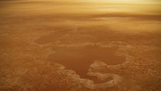 This artist's concept of a lake at the north pole of Saturn's moon Titan illustrates raised rims and rampartlike features such as those seen by NASA's Cassini spacecraft around the moon's Winnipeg Lacus.