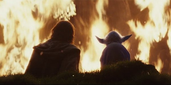 Luke Skywalker sitting with Force ghost Yoda