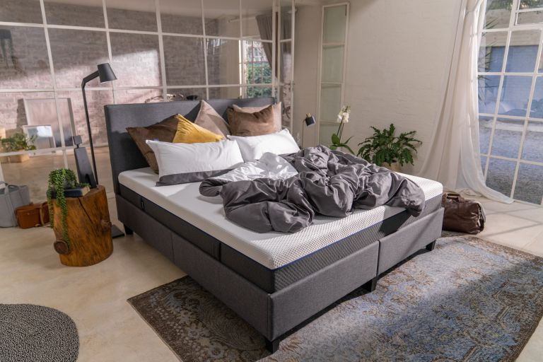 best mattress in a bedroom with house plants