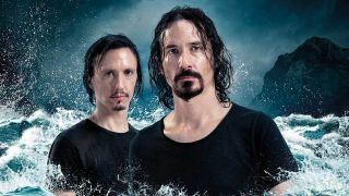 Mario and Joe Duplantier from Gojira standing in the ocean