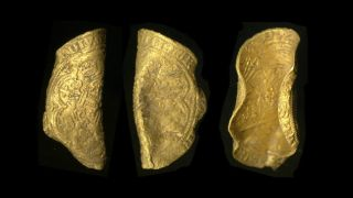 The gold noble coin, as seen from different angles.