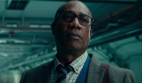 Justice League Joe Morton Dr. Silas Stone worried in one of his lab's corridors