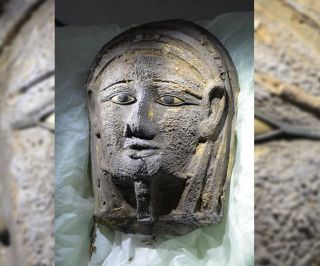 A silver facemask gilded with gold was found on the face of the mummy.