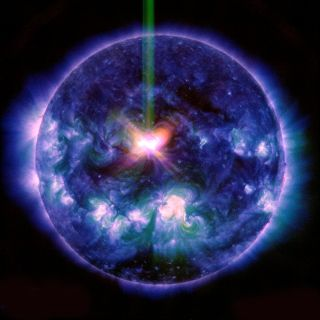 A three wavelength composite view of the X1.6-class solar flare peaking around 17:45 UT on September 10, 2014.