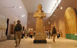 U.S. soldiers patrol the Iraq National Museum, which opened its doors July 3, 2003, for the first time since the April 2003 fall of Saddam Hussein in Baghdad, Iraq. The museum was plagued with weeks of looting that also sacked the museum.