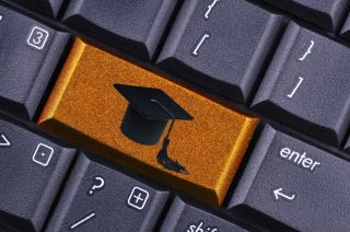 Keyboard with graduation cap on gold key