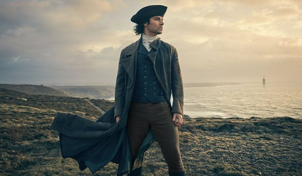 Poldark Aidan Turner looks out to the sea on a cliff