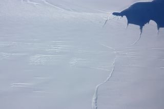 One end of the rift in Antarctica's Pine Island Glacier, seen from the NASA IceBridge DC-8 on Oct. 23, 2012. Since its discovery the crack has spread and is now less than one kilometer from completing and producing a large iceberg.