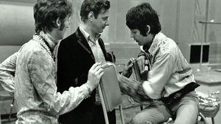 John Lennon, Brian Epstein and Paul McCartney