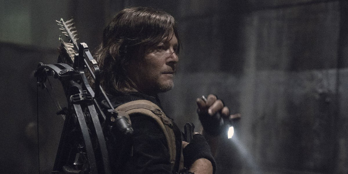 daryl with a flashlight in the sewer on the walking dead season 11