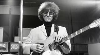 Roger McGuinn on set for The Byrds' performance on Ready Steady Go!, August 6, 1965, in London