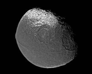 Cracking a Mystery: Space Walnut Created by Moons Crashing