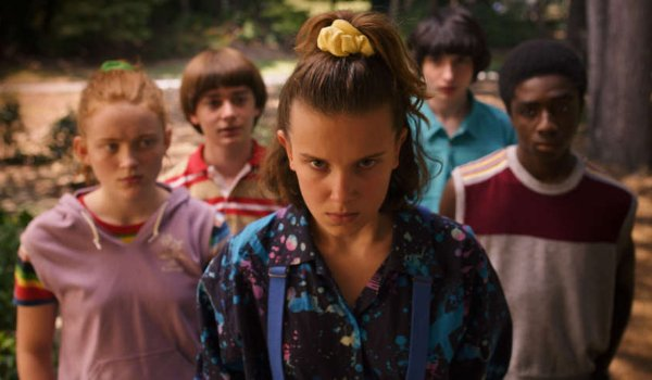 Stranger Things 3 Eleven stares menacingly in front of her pals