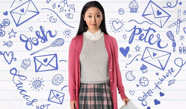 To All The Boys I Loved Before Lana Condor stands in the middle of drawings