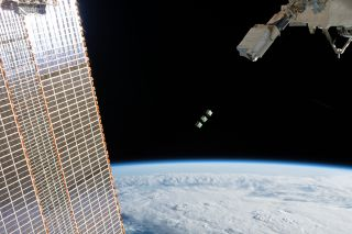 Outside the International Space Station, the Japanese Small Satellite Orbital Deployer ejects three small cubesats into low Earth orbit for the BIRDS-3 mission, which is part of a program to help countries build their first satellites. This batch of cubesats includes Nepal's first satellite, NepaliSat-1, and Sri Lanka's first satellite, Raavana-1. The third is a Japanese cubesat called Uguisu. All three arrived at the space station in April on board a Cygnus cargo spacecraft, and the Expedition 59 crew released them into space on Monday (June 17).