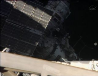 Russian cosmonauts Fyodor Yurchikhin and Alexander Misurkin work outside the International Space Station on Aug. 22, 2013 after beginning a planned six-hour spacewalk.