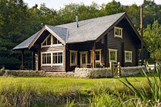 Log cabin self build on a woodland plot in Derbyshire