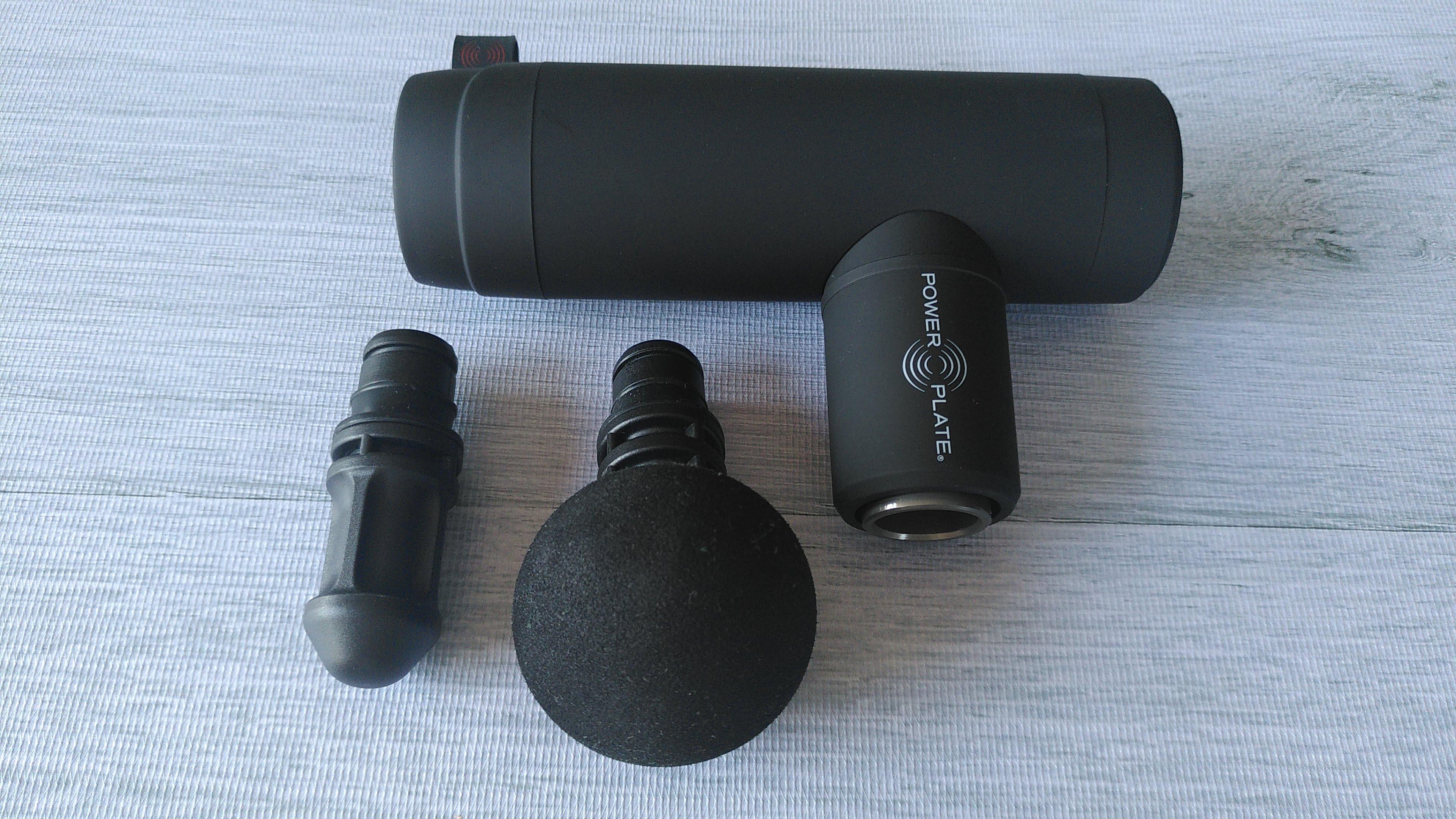 Power Plate Mini+ massage gun with attachments