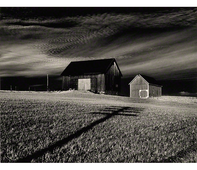 Black and white shots of two barns