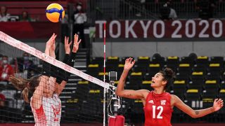 USA's Jordan Thompson (R) hits the ball in the women's preliminary round pool B volleyball match between USA and Turkey during the Tokyo 2020 Olympic Games at Ariake Arena in Tokyo on July 29, 2021.