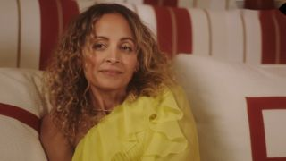 Nicole Richie chilling in a yellow cocktail in her bedroom while giving British Vogue a tour of her Beverly Hills home